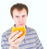 The young man eats a hamburger Stock Images