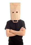 Young man in ecological paper bag on head Stock Photos