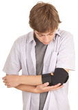 Young man with elbow in medical bandage Royalty Free Stock Image
