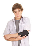 Young man with elbow in medical bandage Royalty Free Stock Photos