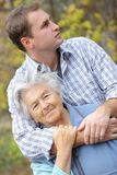 Young man and elderly woman Stock Photos