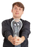 Young man with electric bulb in hands Stock Photography