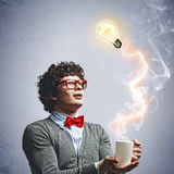 Young man with an electric bulb Royalty Free Stock Photo