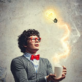 Young man with an electric bulb Stock Image