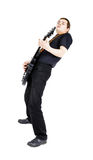 Young man with an electric guitar. Isolated Royalty Free Stock Image