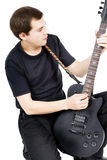 Young man with an electric guitar. Isolated Royalty Free Stock Photography