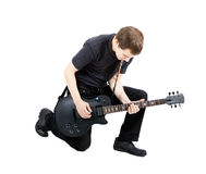 Young man with an electric guitar. Isolated Stock Photography