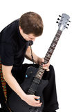 Young man with an electric guitar. Isolated Stock Image