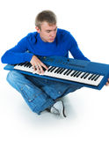 Young man with an electronic piano. On a white background Stock Images