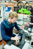 Young man in electronics workshop Royalty Free Stock Photography