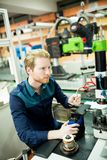 Young man in electronics workshop Royalty Free Stock Images
