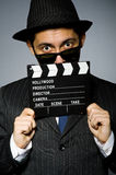 Young man in elegant suit holding clapperboard Stock Photos