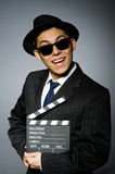 Young man in elegant suit holding clapperboard Royalty Free Stock Images