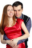 Young man embraces beautiful woman in red. stock photography