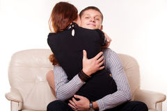Young man embraces woman Royalty Free Stock Photography