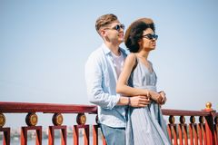 young man embracing stylish african american girlfriend royalty free stock photos