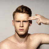 Young man emotional portrait Stock Photos