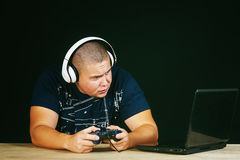 A young man emotionally playing computer games Royalty Free Stock Photos