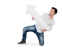 Young man with empty arrow Royalty Free Stock Photography