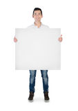 Young man with empty board Royalty Free Stock Images