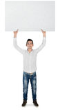 Young man with empty board Stock Photos
