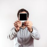 Young man with empty photo frame i over the face Stock Image