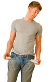 Young man with empty pockets Stock Photography