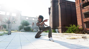 Young man ending off his hip hop dance with a bow Stock Photo