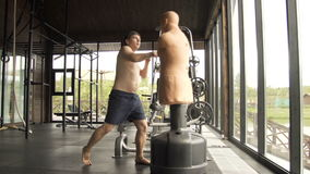 A young man is engaged in boxing in the gym. A young man is engaged in boxing stock video
