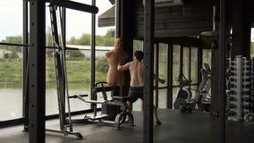 A young man is engaged in boxing in the gym. A young man is engaged in boxing stock footage