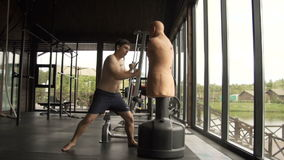 A young man is engaged in boxing in the gym.120fps. A young man is engaged in boxing stock video
