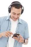 Young man enjoy listening music on mobilephone with headphones Royalty Free Stock Photo