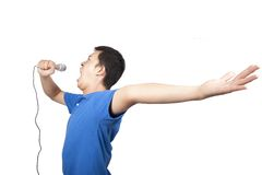 Young man enjoy singing. Young man with a microphone enjoy singing Royalty Free Stock Photography