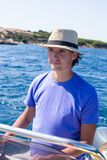 Young man enjoy summer vacation on boat Royalty Free Stock Image