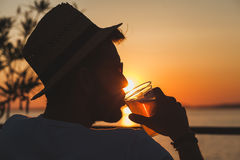 Young man enjoying at a beach bar. Young man enjoying sunset at a beach bar Stock Images