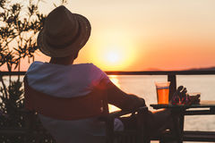 Young man enjoying at a beach bar. Young man enjoying sunset at a beach bar Stock Photography