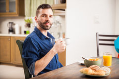 Young man enjoying breakfast at home Royalty Free Stock Images