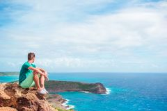 Young man enjoying breathtaking views from Shirley Heights on Antigua island in Caribbean Stock Image
