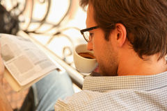 Young man enjoying in cafe Stock Image