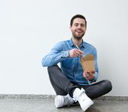 Young man enjoying chinese food Royalty Free Stock Image