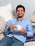 Young man enjoying a coffeebreak Royalty Free Stock Image
