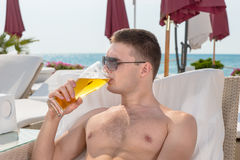 Young man enjoying a cold beer Royalty Free Stock Photo
