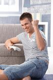 Young man enjoying computer game at home Royalty Free Stock Photography