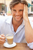 Young Man Enjoying Cup Of Coffee Royalty Free Stock Image