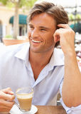 Young Man Enjoying Cup Of Coffee Stock Image