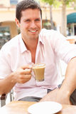 Young Man Enjoying Cup Of Coffee Royalty Free Stock Photo
