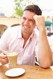 Young Man Enjoying Cup Of Coffee Stock Images