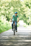 Young Man Enjoying Cycle Ride In The Countryside Royalty Free Stock Image