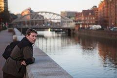 Young man enjoying evening sundown in a German city Stock Photos