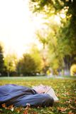 Young man enjoying fall. Young man lying down in the fall leaves Stock Photography